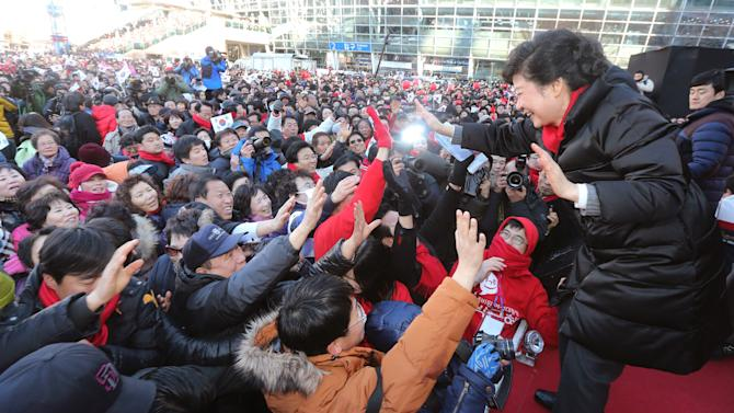 South Korea's presidential candidate Park Geun-hye of ruling Saenuri Party greets supporters during her presidential election campaign in Busan, South Korea, Tuesday, Dec. 18, 2012, a day before the presidential election. (AP Photo/Yonhap. Lee Ji-eun)  KOREA OUT