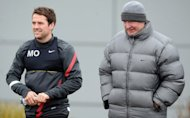 Manchester United manager Alex Ferguson (R) with English forward Michael Owen for a training session in Manchester, north-west England, on February 22, 2012. United have called time on Owen's Old Trafford career after the striker revealed on Thursday that he would not be offered a new contract by the club