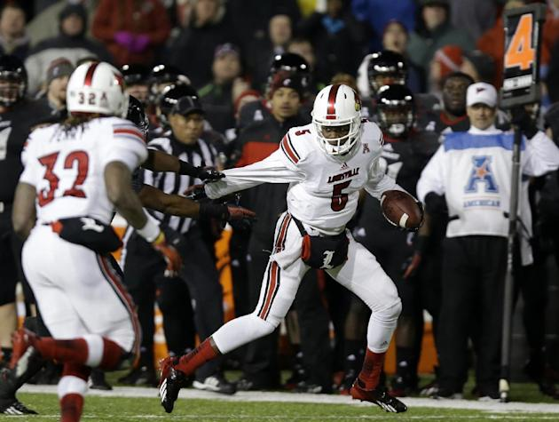 Louisville quarterback Teddy Bridgewater (5) runs for 14 yards on a fourth down play with 12 yards to go late in the fourth quarter of an NCAA college football game against Cincinnati, Thursday, Dec.