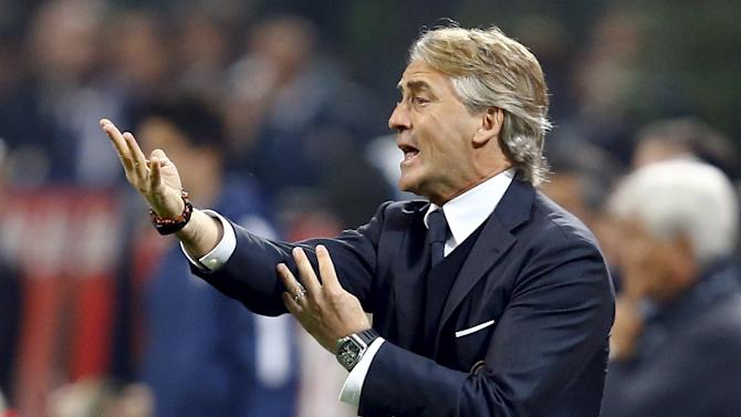 Inter Milan's coach Mancini gestures during their Serie A soccer match against AS Roma at the San Siro stadium in Milan