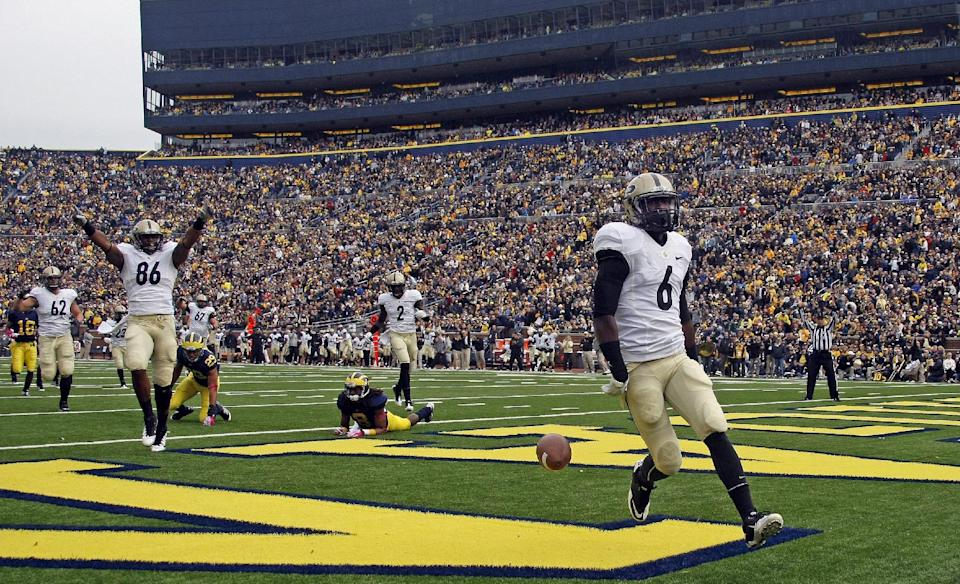 Purdue wide receiver Gary Bush (6) celebrates his touchdown in the first quarter of an NCAA college football game against Michigan, Saturday, Oct. 29, 2011, in Ann Arbor, Mich. (AP Photo/Tony Ding)