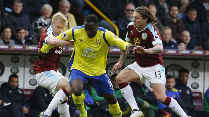 Everton's Romelu Lukaku in action with Burnley's Jeff Hendrick and Ben Mee