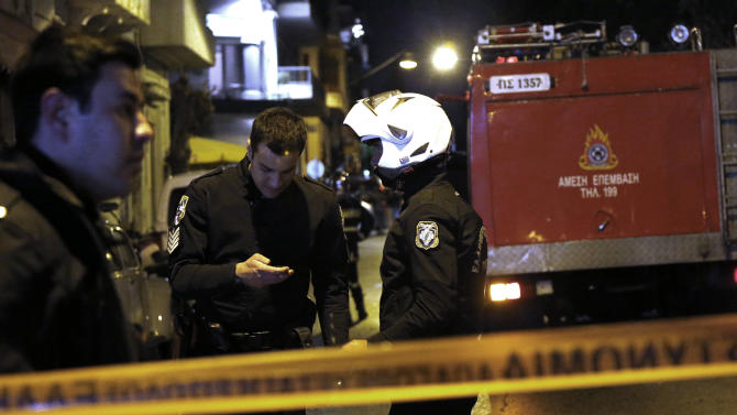 Police set up a cordon after a bomb exploded at the home of a Greek shipowner, opposite the Acropolis in central Athens on Wednesday, March 27, 2013. No one was hurt in the evening blast that  followed a warning telephone call to an Athens newspaper. Small bomb attacks by far-left and anarchist groups are common in Greece. (AP Photo/Dimitri Messinis)