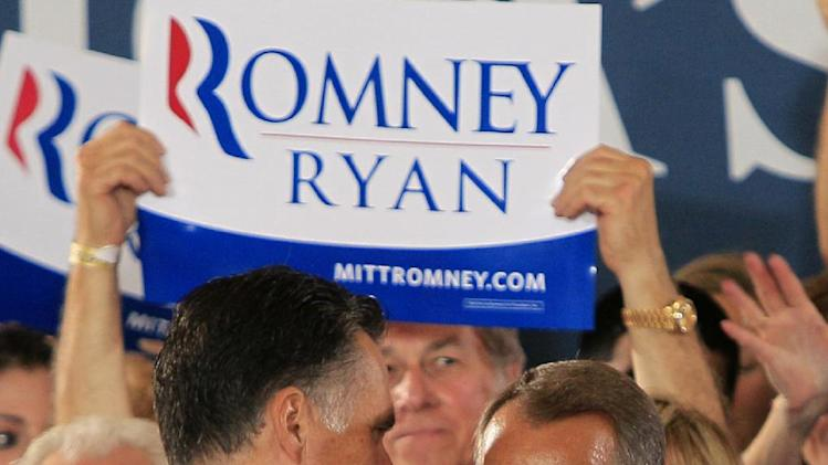Republican presidential candidate, former Massachusetts Gov. Mitt Romney shakes hands with House Speaker John Boehner of Ohio during a victor rally, Saturday, Sept. 1, 2012, at Union Terminal in Cincinnati. (AP Photo/Al Behrman)