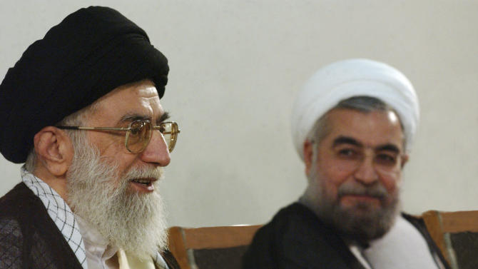 """In this photo taken on Sunday, June 16, 2013, and released by the official website of the Iranian supreme leader's office, supreme leader Ayatollah Ali Khamenei, left, speaks during his meeting with President-elect Hasan Rowhani in Tehran, Iran. On Sunday, Rowhani had his first meeting as president-elect with Khamenei, who offered """"necessary guidelines"""" to him, state TV said, without elaborating. (AP Photo/Office of the Supreme Leader)"""