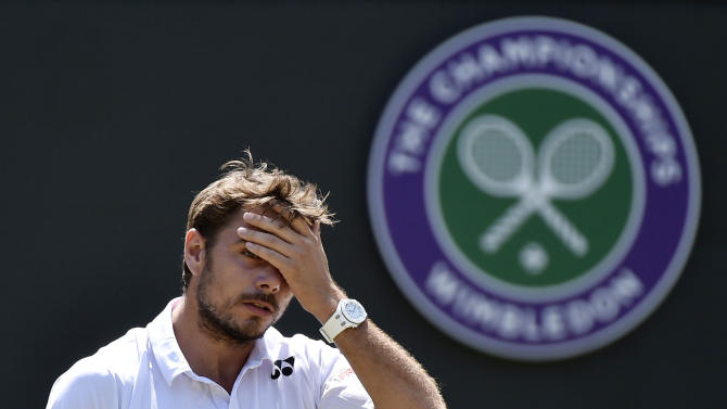 Stan Wawrinka of Switzerland reacts during his match against Fernando Verdasco of Spain at the Wimbledon Tennis Championships in London