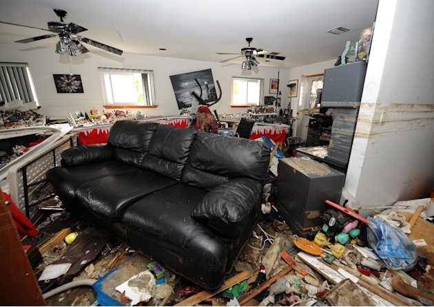 Debris covers the lower floor of Don Durando's house in Long Beach, N.Y. Thursday, Nov. 1, 2012, after sustaining flooding and other damage from Superstorm Sandy. Three days after Sandy slammed the mi