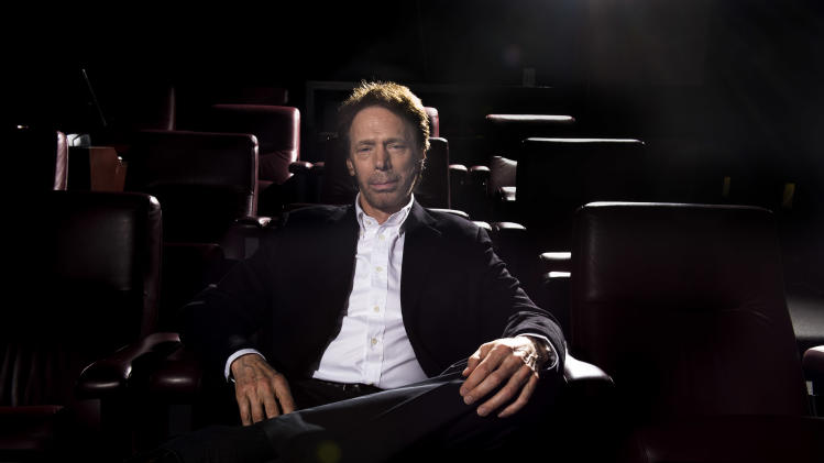 "In this Monday, Jan. 13, 2014 photo, Jerry Bruckheimer poses for a portrait at his office in Santa Monica, Calif. After more than two decades with Disney, where he produced the juggernaut ""Pirates of the Caribbean"" and ""National Treasure"" film franchises among many box-office hits, Bruckheimer begins a new partnership with Paramount in March 2014. At Disney's behest, he closes his previous chapter with a photo book as outsized as some of his productions: ""Jerry Bruckheimer: When Lightning Strikes - Four Decades of Filmmaking"" is a 10-pound, 300-page chronicle of his career in pictures. (Photo by Jordan Strauss/Invision/AP)"