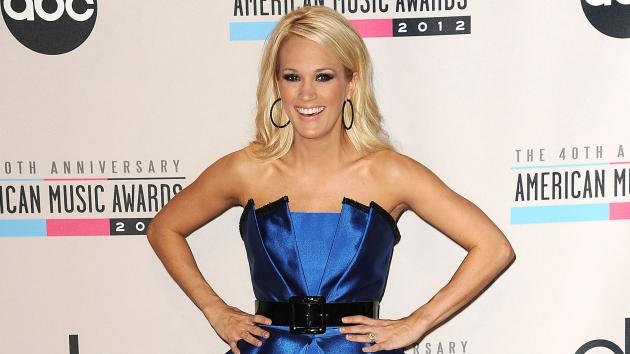 Carrie Underwood poses in the press room at the 40th American Music Awards at Nokia Theatre L.A. Live on November 18, 2012 in Los Angeles -- Getty Premium