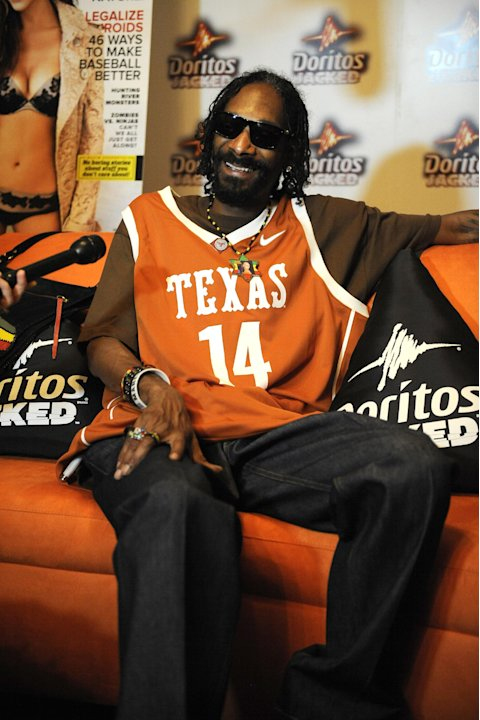 COMMERCIAL IMAGE - In this photograph taken by AP Images for Doritos, Snoop Dogg relaxes backstage at the Doritos JACKED Maxim Party in Austin, Texas, Thursday, March 15, 2012. The 56-foot-tall vendin