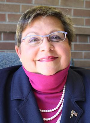 This 2011 photo shows Maria Waltherr-Willard, 61, who taught Spanish and French at Mariemont High School in Cincinnati from 1976 until 2009, when she was transferred to the district's middle school. Waltherr-Willard is suing the school district where she used to work, accusing its administrators of discriminating against her because of a rare phobia she says she has: a fear of young children. Waltherr-Willard says the seventh- and eighth-graders at the middle school triggered her phobia, and she was forced to retire in the middle of the 2010-2011 school year. (AP Photo/Community Press, Heidi Fallon)  MANDATORY CREDIT; NO SALES