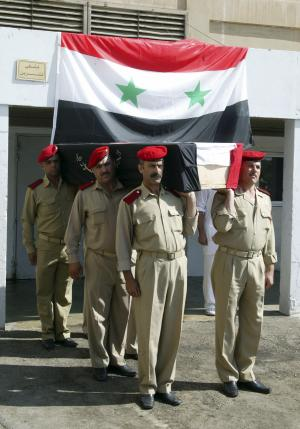 In this photo released by the Syrian official news agency SANA, Syrian soldiers carry the coffin of a killed comrade who was reportedly killed in recent violence in the country, outside a hospital in the western province of Tartous, Syria, Friday, July 15, 2011. A Syrian activist says security forces have killed 14 protesters during anti-government demonstrations across the country. Friday's rallies appeared to be the largest and most widespread since the uprising against President Bashar Assad began in March. (AP Photo/SANA) EDITORIAL USE ONLY