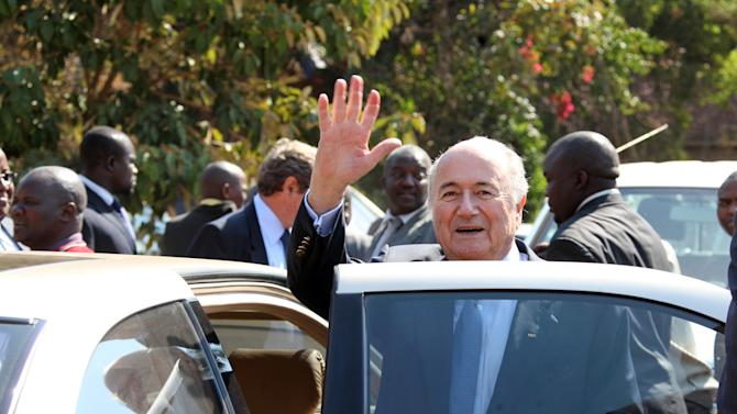 FIFA President Sepp Blatter,centre, during his visit to the  Zimbabwe Football Association Village,  in Mount Hampden about 40 kilometres  west of Harare, Monday, July 4, 2011. FIFA President Sepp Blatter arrived in Zimbabwe on a private jet Monday at the start of a two-day visit to meet administrators of the southern African nation's controversy-mired game. (AP Photo/Tsvangirayi Mukwazhi)
