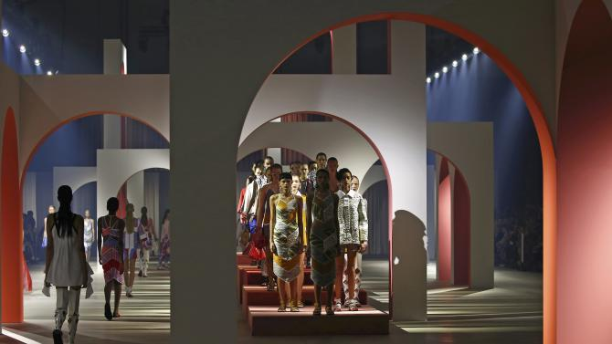 Models present creations by designers Humberto Leon and Carol Lim as part of their Spring/Summer 2016 women's ready-to-wear collection for Japanese fashion house Kenzo in Paris