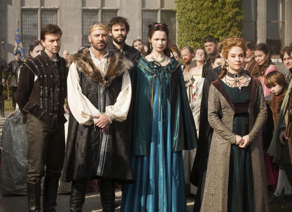 "This publicity image released by The CW shows, from left, Torrance Coombs as Bash, Alan Van Sprang as King Henry II, Rossif Sutherland as Nostradamus, Anna Walton as Diane, and Megan Follows as Catherine de' Medici in a scene from ""Reign."" (AP Photo/The CW, Joss Barratt)"