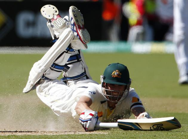 Australia's Lyon dives to make his ground during the second day's play in the second Ashes cricket test against England at the Adelaide Oval