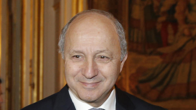 French Foreign Minister Laurent Fabius shakes hands with Malian Prime Minister Sheikh Modibo Diarra, unseen, in Paris, Tuesday, Nov. 27, 2012. The French foreign minister says France plans to vote in favor of recognition of a Palestinian state at the U.N. General Assembly this week, the first major European country to come out in favor. (AP Photo/Christophe Ena)