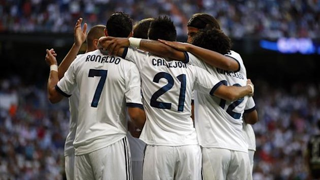Cristiano Ronaldo celebrates with his team-mates (Reuters)
