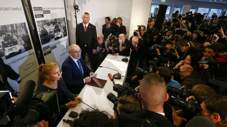Freed Russian former oil tycoon Khodorkovsky sits next to Hildebrandt, director of Museum Haus am Checkpoint Charlie, during his news conference in the museum in Berlin