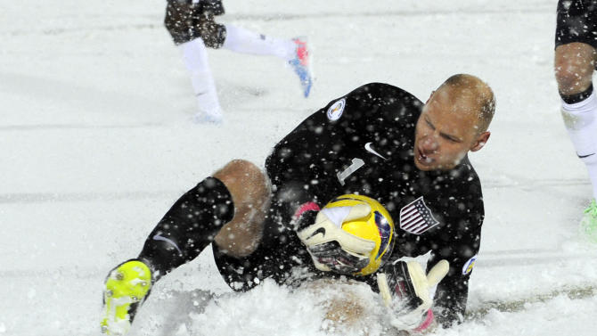 United States goalkeeper Brad Guzan (1) slides in the snow to make a save against Costa Rica during the second half of a World Cup qualifier soccer match in Commerce City, Colo., Friday, March 22, 2013. The United States beat Costa Rica 1-0. (AP Photo/Jack Dempsey)