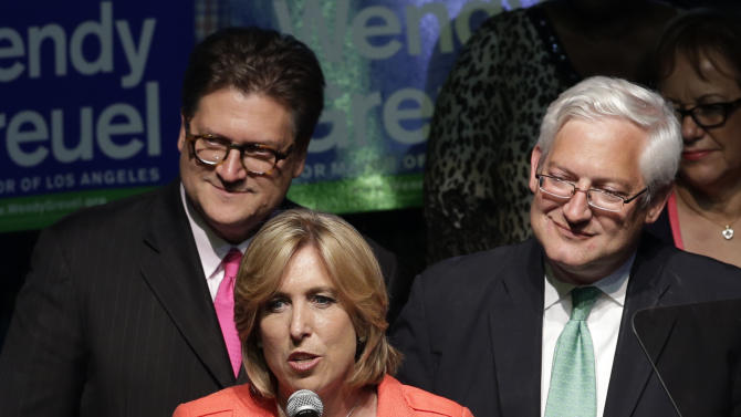 Los Angeles mayoral candidate Wendy Greuel, center, joined by husband Dean Schramm, top right, and son Thomas, right, addresses her supporters at an election night party in Los Angeles, Tuesday, May 21, 2013. Councilman Eric Garcetti held a slender edge Tuesday in early returns over city Controller Wendy Greuel to become the next Los Angeles mayor, while slow-coming returns suggested it could take a day or more until a winner emerges. (AP Photo/Jae C. Hong)