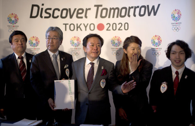 <p>               Naoki Inose, Governor of Tokyo, center, gestures to the media, with Teru Fukui, Minister in charge of sports, left, Tsunekazu Takeda, Tokyo 2020 President, Japanese Olympic Committee President and IOC Member, second left, Homare Sawa, Tokyo 2020 bid ambassador and soccer Olympian and Takayuki Suzuki, right, Tokyo 2020 bid ambassador and double bronze medalist in the London 2012 Paralympic Games, as they pose for the photographers following their first international presentation of their bid for the 2020 Olympic Games, in London, Thursday, Jan. 10, 2013. (AP Photo/Alastair Grant)