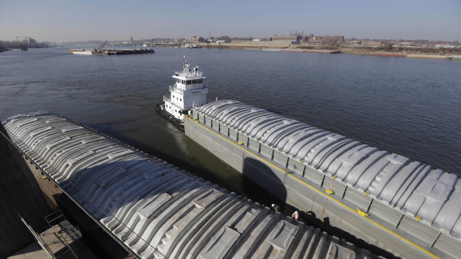 FILE - In this Nov. 28, 2012 file photo, an empty barge, top, pulls along side a barge filled with soybeans as they prepare to switch places at an Archer Daniels Midland grain river terminal along the Mississippi River in Sauget, Ill. A key stretch of the Mississippi River reopened to shipping Wednesday, Jan. 23, 2013 after hasty repairs were made to a lock damaged by a barge, marking the latest victory for stewards of the drought-plagued waterway they have maneuvered to keep open. Barge operators have faced challenges for months on the drought-plagued river, including increasingly shallower water and a 17-hour shutdown, on Tuesday, Jan . 22, 2013, of a damaged lock upriver near Granite City, Ill. (AP Photo/Jeff Roberson, File)