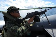 Philippine marines patrol along Ulugan Bay, facing the South China Sea. The United States and the Philippines called for freedom of navigation in the tense South China Sea as the White House offered a robust show of support for President Benigno Aquino