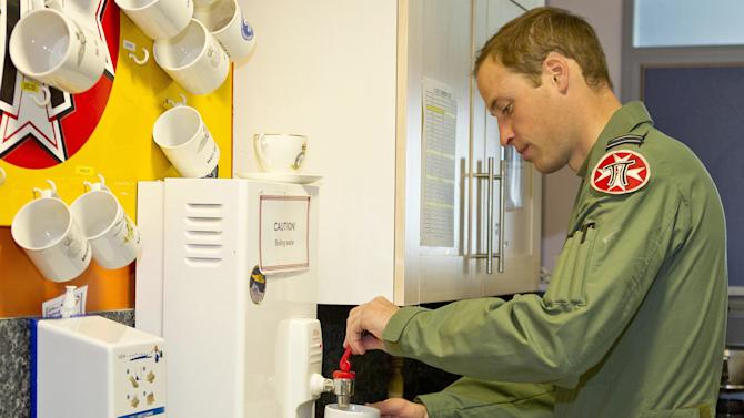 "This is an undated handout photo issued by www.dukeanduchessofcambridge.org on Tuesday Nov. 20, 2012 of Britain's Prince William making a cup of tea whilst working as a helicopter search and rescue pilot at RAF Valley on Anglesey, Wales. The picture show a typical ""day in the life"" for Prince William in his work flying RAF Sea King helicopters from their base at RAF Valley on Anglesey, north Wales. From planning and preparing for any emergency callout to resting with his colleagues during ""downtime"", the exclusive pictures give an insight into the life of Flight Lieutenant Wales in his day-job as a Search and Rescue (SAR) pilot. (AP Photo/ SAC Faye Storer/MoD, www.dukeanduchessofcambridge.org) NO ARCHIVE  EDITORIAL USE ONLY"
