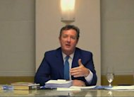 In this image made from video, CNN star interviewer Piers Morgan answers questions Tuesday, Dec. 20, 2011 from a media ethics inquiry sitting in London, England, about his time at the top of Britain&#39;s tabloid industry, at an unknown location in the U.S. Morgan ran two British tabloids - the News of the World and the Daily Mirror - before his editorship was cut short by scandal in 2004. (AP Photo, Pool)