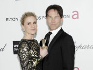 "FILE - This Feb. 26, 2012 file photo shows Anna Paquin and Steven Moyer arriving at the Elton John AIDS Foundation Academy Awards viewing party in West Hollywood, Calif. Reps for the actor-couple confirm Paquin gave birth to the babies ""a few weeks early"" but say they're ""in good health"" and their parents ""are overjoyed."" The statement issued Tuesday didn't specify when or where the babies were born or the sex of the children. (AP Photo/Dan Steinberg, file)"