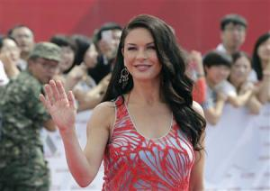 British actress Catherine Zeta-Jones waves to fans as she arrives for the launch ceremony of the Qingdao Oriental Movie Metropolis on the outskirts of Qingdao