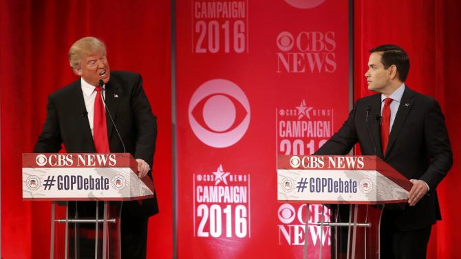 Republican U.S. presidential candidate Trump speaks as Rubio looks on at the Republican U.S. presidential candidates debate sponsored by CBS News and the Republican National Committee in Greenville