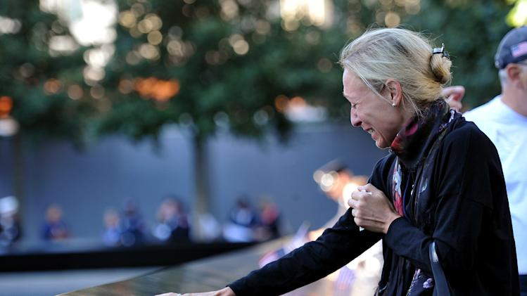 Alicia Watkins remembers a friend who died at the Pentagon during a ceremony marking the 11th anniversary of the Sept. 11 attacks at the National September 11 Memorial at the World Trade Center site in New York, Tuesday, Sept. 11, 2012. (AP Photo/The Daily News, Todd Maisel, Pool)