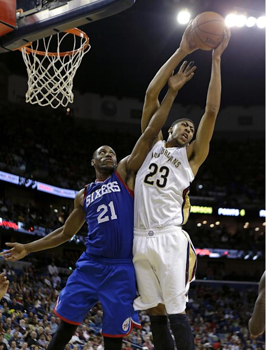 New Orleans Pelicans power forward Anthony Davis (23) grabs a rebound over Philadelphia 76ers power forward Thaddeus Young (21) in the first half of an NBA basketball game in New Orleans, Saturday, No