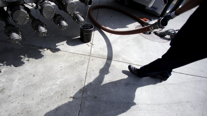 FILE - In this Friday, Oct. 5, 2012, file photo, a gas truck delivery driver fills the tanks at a gas station in Garden Grove, Calif. Higher gas costs drove up U.S. consumer prices in September for the second straight month. But outside energy, there was little sign of inflation. NYB (AP Photo/Chris Carlson, File)