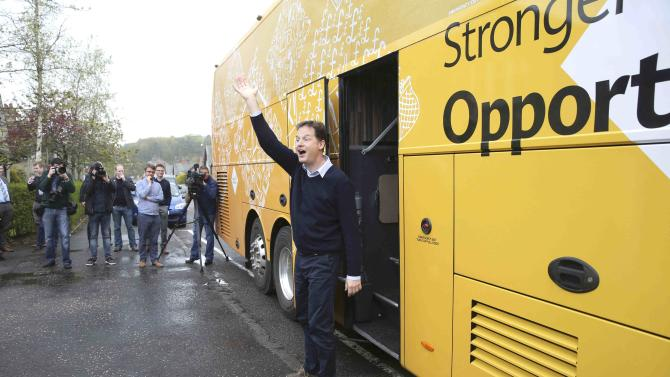 Leader of the Liberal Democrat party Nick Clegg waves to young children as he leaves the Westerton nursery during a campaign event in Glasgow