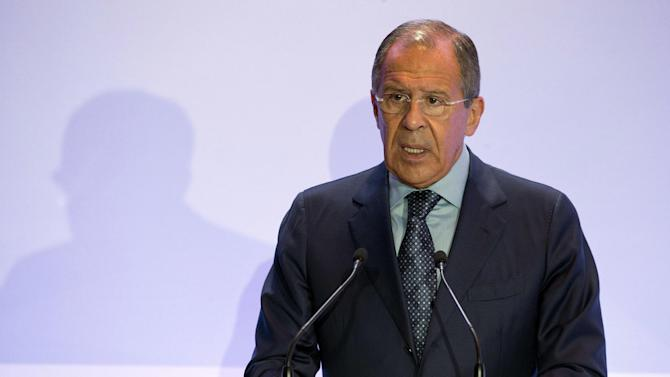 Russian Foreign Minister Sergey Lavrov addresses a security conference in Moscow, Russia on Friday, May 23, 2014. Lavrov on Friday urged the West to stop playing what he described as a zero-sum game against Russia and reach a settlement based on mutual interests. (AP Photo/Pavel Golovkin)