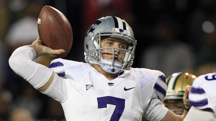 Kansas State quarterback Collin Klein (7) throws a touchdown pass during the first quarter of an NCAA college football game against the Baylor on Saturday, Nov. 17, 2012, in Waco, Texas. (AP Photo/LM Otero)