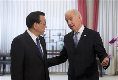 U.S. Vice President Joe Biden chats with Chinese Premier Li Keqiang before heading to their meeting at the Zhongnanhai diplomatic compound in Beijing