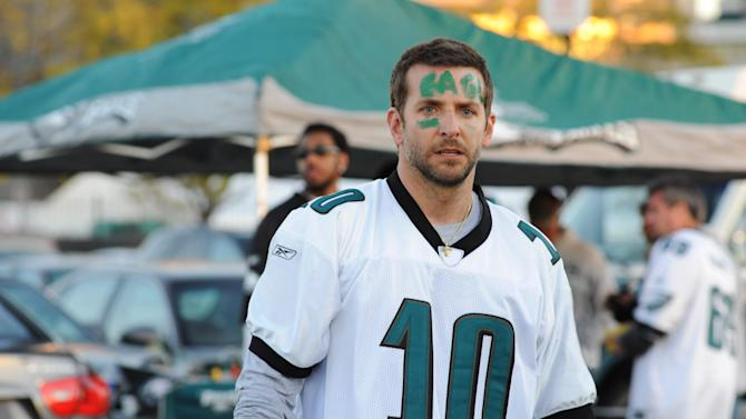 """This undated publicity film image provided by The Weinstein Company shows Bradley Cooper playing Pat Solatano in a scene from the film, """"Silver Linings Playbook.""""  As large a role as football plays in American life, Hollywood has typically focused its cameras on the field of play, where the dramatics of gridiron battle are self-evident. """"Silver Linings Playbook,"""" was recently nominated for five Spirit Awards and is widely expected to be a best picture Oscar contender. (AP Photo/The Weinstein Company, JoJo Whilden)"""
