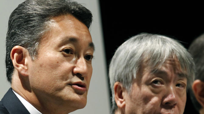 Sony Corp. President and Chief Executive Officer Kazuo Hirai, left, speaks during a press conference with President of Olympus Corp. Hiroyuki Sasa, right, in Tokyo, Monday, Oct. 1, 2012. Sony's new alliance with scandal-tarnished Olympus will produce endoscopes and other surgical tools packed with the Japanese electronics and entertainment maker's three-dimensional imagery and super-clear display technology called 4K. (AP Photo/Koji Sasahara)