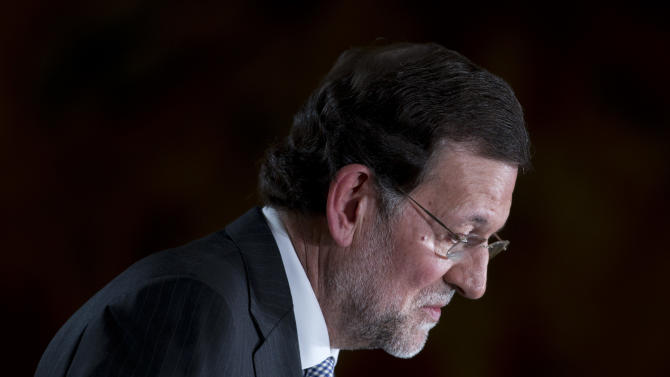 "Spain's Prime Minister Mariano Rajoy pauses as he makes a speech at the Moncloa Palace in Madrid, Friday Dec. 28, 2012. In his end of year assessment, Mariano Rajoy said Friday the crisis had been worse than he had anticipated and that the first half of 2013 will be ""very hard,"" but that the economy should begin to recover in the second semester.Rajoy says the country's economy will be in recession for some time and faces a tough year ahead as it grapples with a deep financial crisis and 25 percent unemployment. (AP Photo/Paul White)"