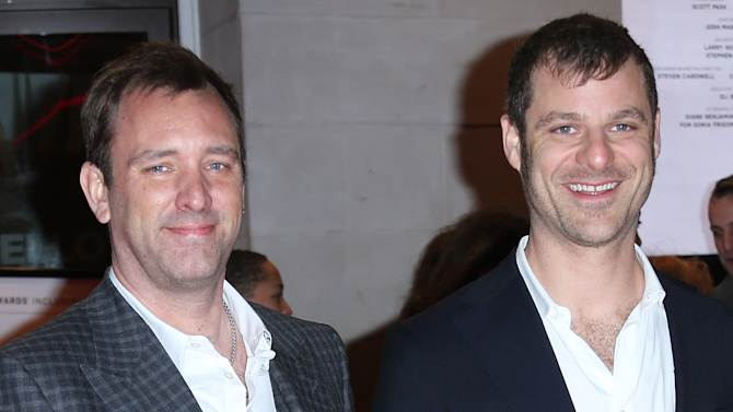 The Book of Mormon creators Trey Parker, left, and Matt Stone pose for photographers on the red carpet as they arrive for the opening night of 'The Book of Mormon' at The Prince of Wales theatre in central London, Thursday, March 21, 2013. (Photo by Joel Ryan/Invision/AP)