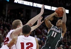 No. 13 Michigan State beats Wisconsin 49-47