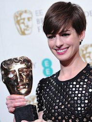 US actress Anne Hathaway poses with the award for best supporting actress for her performance in the film Les Miserables during the annual BAFTA British Academy Film Awards at the Royal Opera House in London on February 10, 2013