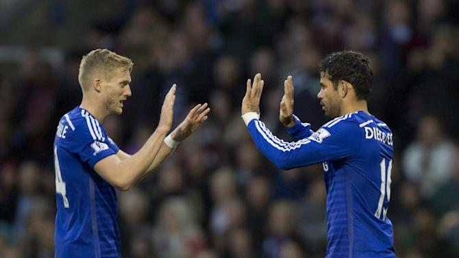 Chelsea's Diego Costa, right, celebrates with teammate Andre Schurrle after scoring against Burnley during their English Premier League soccer match at Turf Moor Stadium, Burnley, England, Monday Aug. 18, 2014. (AP Photo/Jon Super)