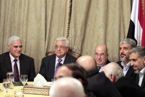 Egypt intelligence chief Muwafi, Palestinian President Abbas, Head of Palestinian National Council al-Zanoun, Hamas leader Meshaal are seen during a meeting in Cairo