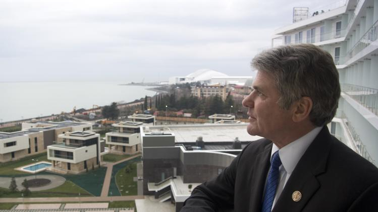 U.S. Congressman, Rep. Michael McCaul, Chairman of the House Homeland Security Committee, stands of a balcony of his hotel which overlooks the Olympic Park, in the Black Sea resort of Sochi, Tuesday, Jan. 21, 2014. Michael McCaul who was in Sochi on Tuesday to assess the situation said he was impressed by the work of Russian security forces but troubled that potential suicide bombers had gotten into the city despite all of the extraordinary security measures. (AP Photo/Nataliya Vasilyeva)