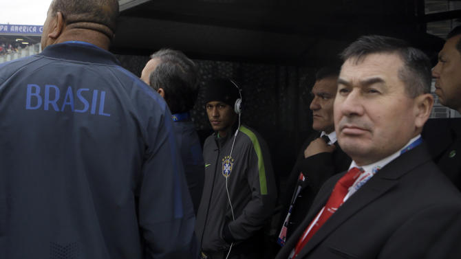 FILE - In this June 21, 2015, file photo, Brazil's Neymar sits on the sidelines before a Copa America Group C soccer match between Brazil and Venezuela at the Monumental stadium in Santiago, Chile. Neymar was handed a four games suspension after the Brazil-Colombia match. Brazil has a generation with few top stars and is heavily dependent on the Barcelona's star, who could not play in last year's semifinal against Germany because of an injury. He also missed the decisive stages of the Copa America this year, because of the suspension. (AP Photo/Luis Hidalgo,File)